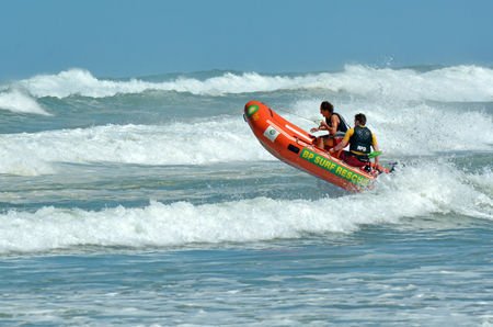 drowned: MURIWAI, NZL -  JAN 01 2015:New Zealand Lifeguards on duty.NZ has the 3rd highest drowning rate in the developed world.In 2013, 98 people drowned in New Zealand waters.