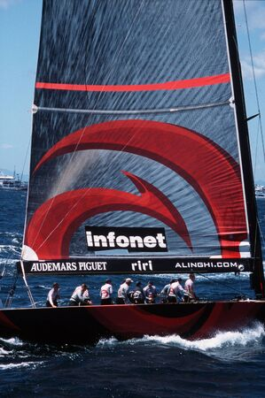 barker: AUCKLAND - MARCH 1:Team Alinghi sails it yacht during the Americas cup of 2003 on March 01 2003 in Auckland New Zealand.It was contested between the holder, Team New Zealand, and the winner of the 2003 Louis Vuitton Cup, Alinghi. Editorial