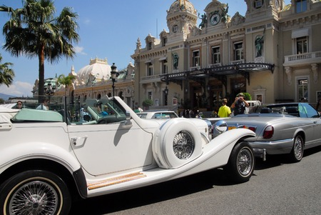 monte carlo: Luxury cars outside Monte Carlo Casino. Editorial