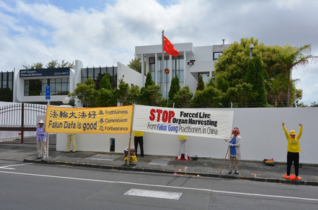 body parts: AUCKLAND - JAN 09 2015:Falun Gong movement  protest outside the Chines Embassy. It claimed since 2000 almost 40,000 transplants have been carried out using body parts harvested from executed members.