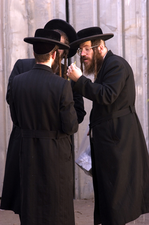 tabernacles: JERUSALEM - OCTOBER 20: Jewish ultra-orthodox people inspect Lulav at a four species market in Mea Shearim for the Jewish holiday of Sukkot on October 20 2005 in  in Jerusalem, Israel.