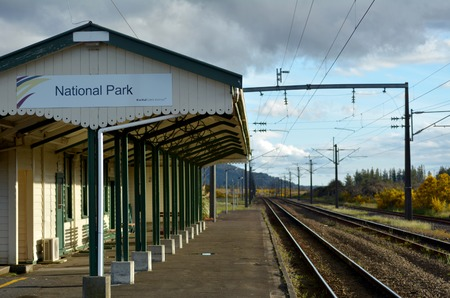 metres: NATIONAL PARK, NZ - DEC 8 2014:National Park Railway Station.At an elevation of 806.8 metres 2,647 ft, it is the highest railway station in New Zealand with a scheduled passenger stop. Editorial