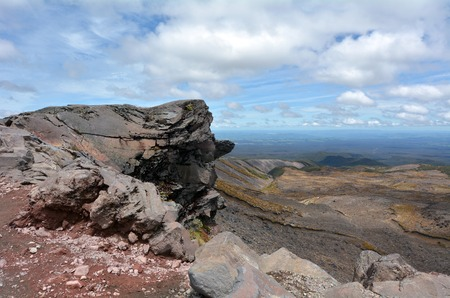 tramping: NATIONAL PARK, NZ - DEC 8 2014:Landscape of Tongariro National Park.The Tongariro Alpine Crossing is considered one of New Zealands top tramping experiences and one of the best day walks in the world