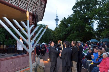 jewish community: AUCKLAND, NZL - DEC 16 2014:The Jewish community celebrates the festival of Hanukkah. Its an eight-day festival commemorating the rededication of the Holy Temple in Jerusalem in the 2nd century BC.