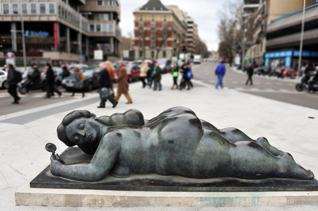 naked statue: A statue of a fat naked lady in the Paseo del Prado in Madrid Spain. Editorial