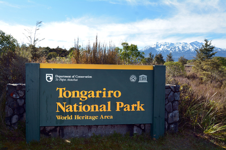 acknowledged: NATIONAL PARK, NZ - NOV 25 2014:Sign of Tongariro National Park.It has been acknowledged by UNESCO as one of the 28 mixed cultural and natural World Heritage Sites. Editorial