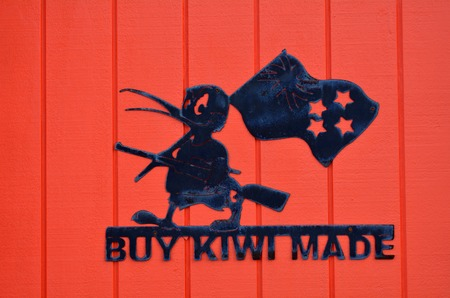 new economy: AUCKLAND, NZL - DEC 08 2014:Buy Kiwi Made sign. New Zealand economy was historically dominated by the export of wool,but today exports of dairy products, meat, wine and tourism, are more significant. Editorial