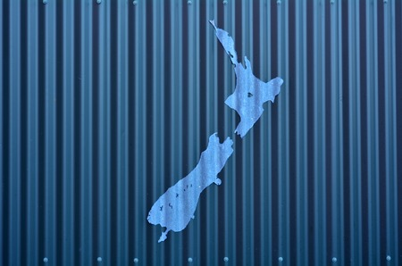 aotearoa: AUCKLAND, NZL - DEC 08 2014:Artwork of New Zealand shape on a wall. Because of New Zealand remoteness in the world, it was one of the last lands to be settled by humans. Editorial