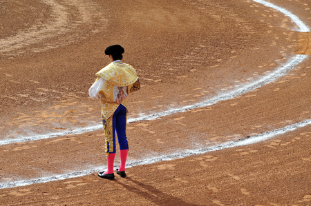 standoff: A Matador and a bull are in a standoff before engaging in a bullfight battlein Mexico city