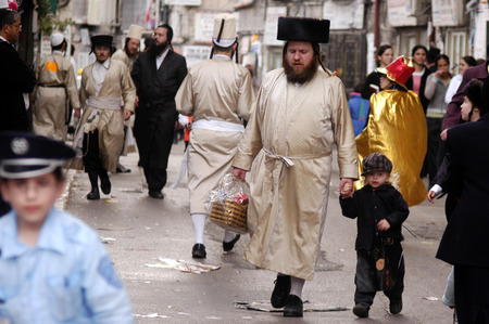 esther: JERUSALEM - MARCH 15: Ultra-orthodox Jewish people celebrates the Jewish holiday Purim on March 15 2006 in Mea Shearim in Jerusalem, Israel.