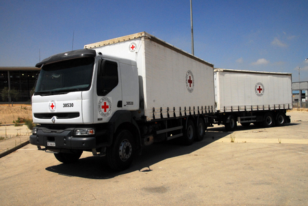 humanitarian aid: EREZ CROSSING, ISR - JUNE 22:A red cross truck at Erez crossing, Israel on June 22, 2008.The Red Cross has won the Nobel Peace Prize three times 1917, 1944, and 1963.