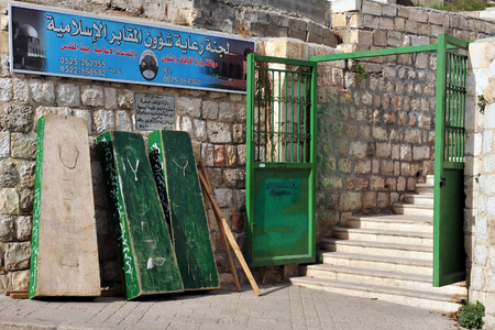 preceded: JERUSALEM -NOVEMBER 12: The entarance to a Muslim cemetery graveyard on November 12 2008 outside the walls of the old city in Jerusalem, Israel.Sharia Islamic religious law calls for burial of the body, preceded by a simple ritual involving bathing and sh