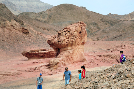 timna: TIMNA, ISR - OCT 15:Visitors in Timna Park on October 15 2008.Its the worlds first copper production center founded my the Egyptian in the in Timna valley over 5000 years ago.