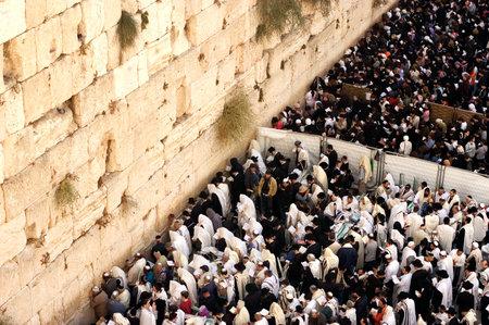 tora: JERUSALEM - OCT 14: Orthodox Jewish pray at the Western Wall during the Jewish holiday of Sukkot on October 14 2008 in Jerusalem, Israel.