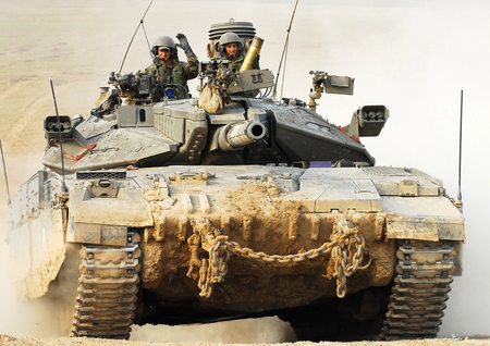 incursion: NACHAL OZ, ISR - NOV 12:Israeli soldiers drive Merkava on NOV 12 2008.Its IDF battle tank  designed for rapid repair of battle damage, survivability, cost-effectiveness and off-road performance. Editorial