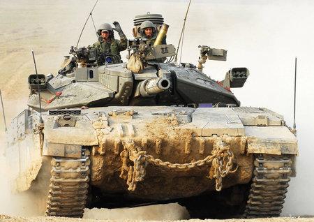 NACHAL OZ, ISR - NOV 12:Israeli soldiers drive Merkava on NOV 12 2008.It's IDF battle tank  designed for rapid repair of battle damage, survivability, cost-effectiveness and off-road performance. Editorial