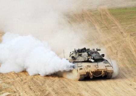 gaza: NACHAL OZ, ISR - NOV 12:Merkava patrols along Gaza on NOV 12 2008.Its IDF battle tank designed for rapid repair of battle damage, survivability, cost-effectiveness and off-road performance.