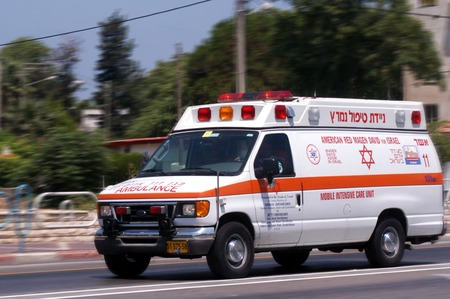 middle east war: NAHARIYA, ISR - JULY 26:Israeli Magen David Adom ambulans on July 26 2006.Since June 2006, Magen David Adom has been officially recognized by the Red Cross ICRCas the national aid society of Israel.