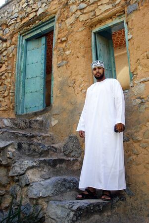MISFA, OMAN - DEC 29 2007:Omani man wearing dishdash in Misfah,Oman.Its an ankle-length garment commonly worn in Arab countries. Editorial