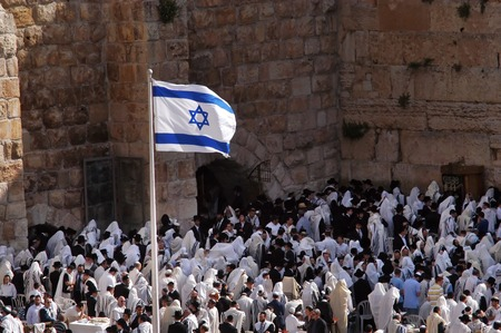 JERUSALEM - APRIL 07: Jewish orthodox pray at the western wall during the holiday of Passover in Jerusalem old city, Israel on April 07 2008.