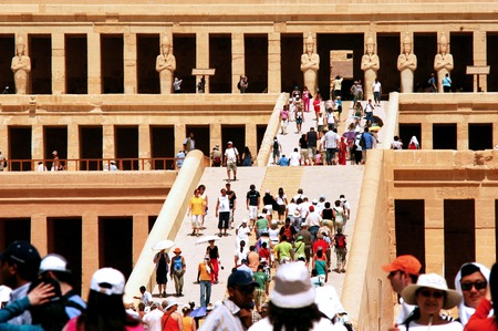 egypt revolution: LUXOR - MAY 02:Visitors at the Great Temple of Hatshepsut on May 02 2007 in Luxor Egypt.The number of tourists visiting Egypt dropped by more than a third since the Egyptian revolution on Jan 25 2011.