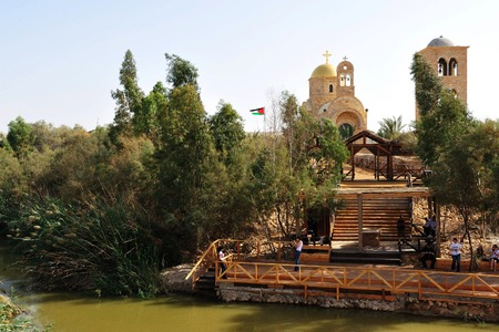 baptized: JERICHO, ISRAEL - DEC 14: Pilgrims in Qasr el Yahud on December 14 2008.According to tradition its the place where the Israelites crossed the Jordan River and where the baptism of Jesus took place. Editorial