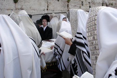 hassid: JERUSALEM - APRIL 07: Orthodox Jewish Pray at the Western Wall during the Jewish holiday of Passover on April 07 2008 in Jerusalem,Israel.Passover is the oldest continuously celebrated Jewish festival Editorial
