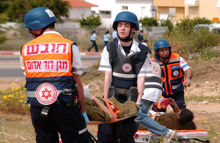 israelis: ASHKELON, ISR - APR 09:Emergency forces are taking part in a drill to simulate a rocket attack on  April 9, 2008.Since 2001 Palestinian rocket attacks on Israel have killed 64 Israelis as of November 21, 2012. Editorial