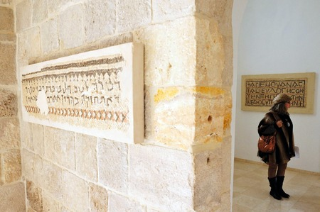 mentioned: JERICHO,ISR - DEC 14:Visitor in the Good Samaritan Church on Dec 14 2008.Its located on the main highway between Jerusalem and Jericho near the site of the inn mentioned in the New Testaments. Editorial