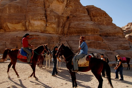 discovered: PETRA - NOV 09:Jordanian man leading tourists on horses to Petra on November 09 2007.It remained unknown to the Western world until 1812,when it was discovered by Swiss explorer Johann L.Burckhardt