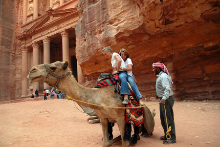 treasury: PETRA - NOV 09:Tourist riding a camel at the Treasury at Petra,Jordan on November 09 2007.Its a symbol of Jordan, as well as its most visited tourist attraction.