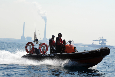 enforcing: ASHKELON, ISR - SEP 03:Israeli water police on Sep 08 2008.Its responsible for enforcing laws relating to water traffic, preventing crime on vessels and providing search and rescue services.
