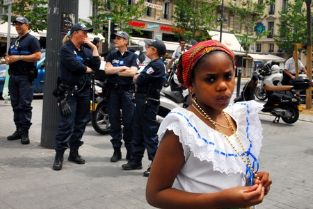 policewomen: MARSEILLE - MAY 10:Young Haitian woman near French policewomen in the street on May 10 2008 in Marseille,France.Marseille is Frances largest city on the Mediterranean coast and largest commercial port.