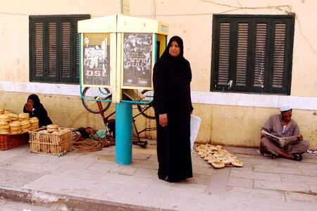 egyptian woman: ASWAN - APRIL 28: Muslim women dressing Hijab in Aswan market, Egypt on April 28 2007.The meaning of the Muslim dressing cod is modesty, privacy, and morality.