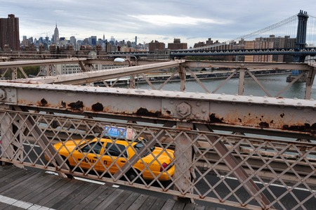 taxicabs: Taxi cab drive over Brooklyn Bridge in Manhattan New York, USA. Editorial