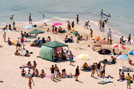 israelis: ASHKELON,ISR - JUNE 19:Visitors in Ashkelon beach on June 19 2005.Its southernmost city on the Israeli Mediterranean shoreline with 12 km of beautiful beaches attracts Israelis and foreign tourists.
