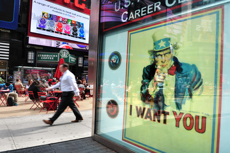 A giant poster of the Uncle Same reads I WANT YOU on the US Army recruit center building in Times Square Manhattan New York, USA.