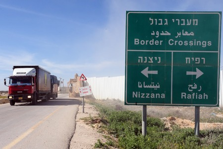 shalom: KEREM SHALOM, ISR - JUNE 21:Cargo entering Gaza at Kerem Shalom crossing on June 21 2009. The crossing is used by trucks carrying goods from Israel to the Gaza Strip. In 2012, the rate of traffic was 250 trucks a day.