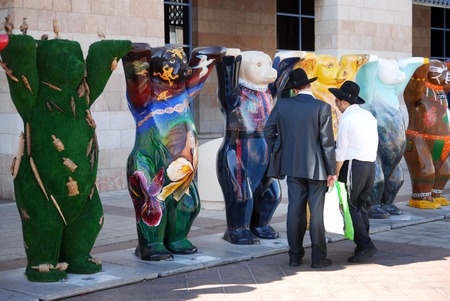 individually: JERUSALEM - AUG 18:United Buddy Bears on August 18 2007.Its an international art exhibition with more than 140 bears represented the UN countries, promoting tolerance and living in peace and harmony. Editorial