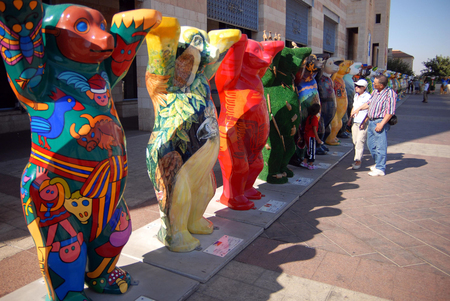 buddy: JERUSALEM - AUG 18:United Buddy Bears on August 18 2007.Its an international art exhibition with more than 140 bears represented the UN countries, promoting tolerance and living in peace and harmony. Editorial