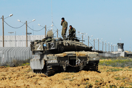shalom: KEREM SHALOM, ISR - FEB 04:Israeli soldiers on Merkava tank on FEB 04 2009.Its IDF battle tank used designed for rapid repair of battle damage, survivability, cost-effectiveness and off-road performance. Editorial