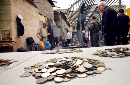 mezuzah: JAFFA,ISR - MAR 09:Old coins at the Flea Market in Jaffa on Mar 09 2008.Its an open air market throughout the year,a magnet for visitors, tourists and lovers of bargains and second hand items
