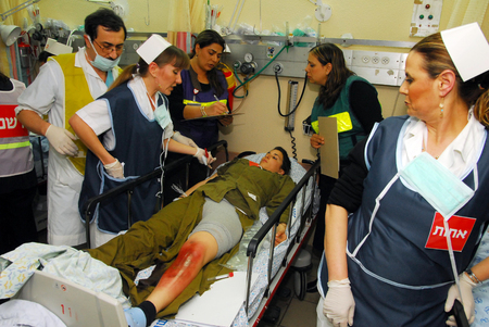 israelis: ASHKELON, ISR - FEB 26: Israeli Medical teams practicing a mass casualty scenario on February 26, 2008.Since 2001 Palestinian rocket attacks on Israel have killed 64 Israelis as of November 21, 2012.