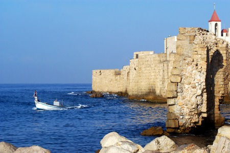 acre: ACRE, ISR - OCT 07:Fishermen fishing at the historic port of Acre on Oct 07 2010.Acre was established as a port city, and became one of the most important cities in the ancient history of Israel.