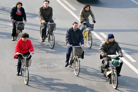 billion: BEIJING - MARCH 11: Chinese people rids bicycles on March 11 2009 in Beijing,China.There are over a half billion bicycles in China. Editorial