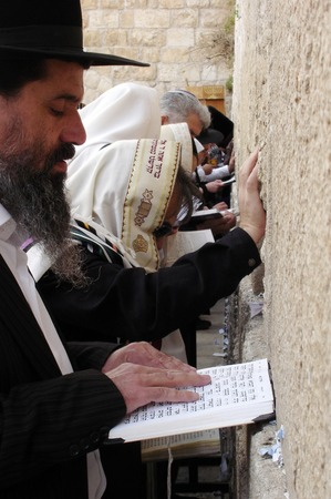 JERUSALEM - APRIL 07: Orthodox Jewish Pray at the Western Wall during the Jewish holiday of Passover on April 07 2008 in Jerusalem,Israel.Passover is the oldest continuously celebrated Jewish festival Editorial