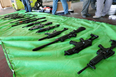 gaza: ASHDOD, ISR - JAN 15:Shipment of imitation guns to Gaza strip exposed by the Israeli customs on Jan 15, 2008.The total value of the global arms market is estimated around 60 billion a year