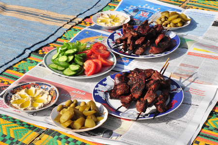 traditional food: LAKIYA,ISR - DEC 12:Cooked lamb meat and salads on Eid al-Adha, Dec 8 2008.The festival is celebrated by sacrificing a lamb or other animal and distributing the meat to relatives, friends, and the poor.