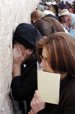 hassid: JERUSALEM - AUG 04: Jewish women pray at the women side of the Western Wall on August 04 2007.Since the Six Day War June, 1967, the Western Wall Plaza has returned to being a place of prayer.