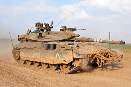 battle tank: NACHAL OZ, ISR - NOV 12:Merkava patrols along Gaza on NOV 12 2008.Its IDF battle tank designed for rapid repair of battle damage, survivability, cost-effectiveness and off-road performance.
